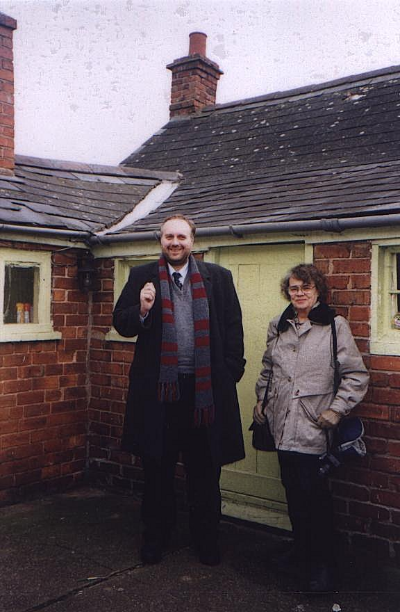 Stephen Roberts and Dorothy Thompson standing at the rear of the cottage